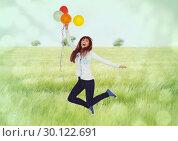 Купить «Happy woman holding balloon against field background», фото № 30122691, снято 23 ноября 2016 г. (c) Wavebreak Media / Фотобанк Лори
