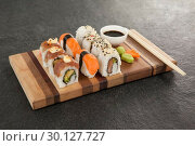 Купить «Assorted sushi set served with chopsticks and soy sauce», фото № 30127727, снято 8 декабря 2016 г. (c) Wavebreak Media / Фотобанк Лори