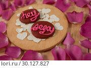 Купить «Cookies iced with pink cream displaying hey sexy», фото № 30127827, снято 8 декабря 2016 г. (c) Wavebreak Media / Фотобанк Лори