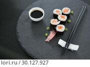Купить «Sushi on tray with soy sauce and chopsticks», фото № 30127927, снято 8 декабря 2016 г. (c) Wavebreak Media / Фотобанк Лори