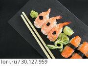 Купить «Sushi with chopsticks», фото № 30127959, снято 8 декабря 2016 г. (c) Wavebreak Media / Фотобанк Лори