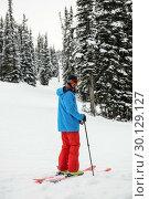 Купить «Skier skiing on snow covered mountains», фото № 30129127, снято 18 ноября 2016 г. (c) Wavebreak Media / Фотобанк Лори