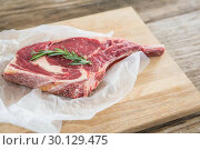 Купить «Rib chop and rosemary herb on wooden tray», фото № 30129475, снято 20 сентября 2016 г. (c) Wavebreak Media / Фотобанк Лори