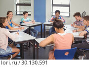 Купить «Students studying in classroom», фото № 30130591, снято 19 ноября 2016 г. (c) Wavebreak Media / Фотобанк Лори