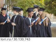 Купить «Graduate school kids standing with degree scroll in campus at school», фото № 30130743, снято 19 ноября 2016 г. (c) Wavebreak Media / Фотобанк Лори