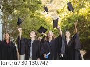 Купить «Successful graduate school kids throwing mortarboard in air in campus», фото № 30130747, снято 19 ноября 2016 г. (c) Wavebreak Media / Фотобанк Лори