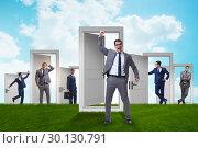 Купить «Businessman in uncertainty concept with many doors», фото № 30130791, снято 20 августа 2019 г. (c) Elnur / Фотобанк Лори