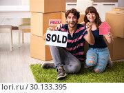 Купить «Young family selling their house», фото № 30133395, снято 21 сентября 2018 г. (c) Elnur / Фотобанк Лори