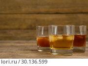 Купить «Three glasses of whiskey with ice cube», фото № 30136599, снято 11 января 2017 г. (c) Wavebreak Media / Фотобанк Лори