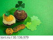 Купить «St Patricks Day shamrock on the cupcake with gold coins», фото № 30136979, снято 11 января 2017 г. (c) Wavebreak Media / Фотобанк Лори
