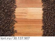 Купить «Coffee beans arranged on wooden table», фото № 30137907, снято 6 октября 2016 г. (c) Wavebreak Media / Фотобанк Лори