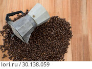 Купить «Coffee beans with metallic coffeemaker», фото № 30138059, снято 6 октября 2016 г. (c) Wavebreak Media / Фотобанк Лори