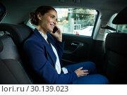 Купить «Business executive talking on mobile phone in car», фото № 30139023, снято 5 октября 2016 г. (c) Wavebreak Media / Фотобанк Лори