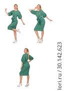 Купить «Young woman in green dress isolated on white», фото № 30142623, снято 22 сентября 2014 г. (c) Elnur / Фотобанк Лори
