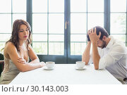Купить «Depressed couple sitting with coffee cup», фото № 30143003, снято 21 ноября 2016 г. (c) Wavebreak Media / Фотобанк Лори