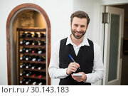 Купить «Male waiter smiling while taking down order», фото № 30143183, снято 21 ноября 2016 г. (c) Wavebreak Media / Фотобанк Лори