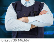 Midsection of security guard with arms crossed. Стоковое фото, агентство Wavebreak Media / Фотобанк Лори