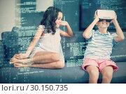 Купить «Girl looking at her brother using virtual reality 3d headset in living room», фото № 30150735, снято 26 января 2017 г. (c) Wavebreak Media / Фотобанк Лори