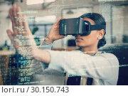 Купить «Businesswoman using virtual reality 3d simulator», фото № 30150743, снято 16 октября 2016 г. (c) Wavebreak Media / Фотобанк Лори