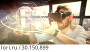 Купить «Composite image of man pointing while wearing virtual reality glasses», фото № 30150899, снято 30 июня 2017 г. (c) Wavebreak Media / Фотобанк Лори