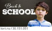 Купить «Back to school text on blackboard with boy», фото № 30151051, снято 24 июля 2017 г. (c) Wavebreak Media / Фотобанк Лори