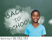 Купить «Back to School text and boy in front of blackboard», фото № 30152151, снято 24 июля 2017 г. (c) Wavebreak Media / Фотобанк Лори