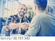 Купить «Confident business people shaking hands», фото № 30157343, снято 15 ноября 2018 г. (c) Wavebreak Media / Фотобанк Лори