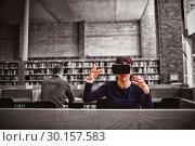 Купить «Woman gesturing while using virtual reality simulator », фото № 30157583, снято 15 ноября 2018 г. (c) Wavebreak Media / Фотобанк Лори