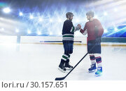 Купить «Composite image of ice hockey players shaking hands at rink», фото № 30157651, снято 15 ноября 2018 г. (c) Wavebreak Media / Фотобанк Лори