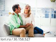 Купить «Couple relaxing on sofa at home», фото № 30158527, снято 4 января 2019 г. (c) Wavebreak Media / Фотобанк Лори