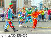 "Купить «Russia Samara August 2018: A group of clowns in bright costumes at the ""Festival of Flowers"" procession», фото № 30159035, снято 25 августа 2018 г. (c) Акиньшин Владимир / Фотобанк Лори"