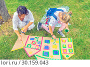 Купить «Russia Samara August 2018: Children's drawing workshop in the park on the grass», фото № 30159043, снято 25 августа 2018 г. (c) Акиньшин Владимир / Фотобанк Лори