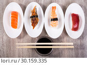 Купить «four kinds of Nigirisushi on oval saucers», фото № 30159335, снято 25 октября 2016 г. (c) Татьяна Яцевич / Фотобанк Лори