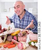 Купить «ordinary men with lots of meat and sausage products», фото № 30159343, снято 17 ноября 2016 г. (c) Татьяна Яцевич / Фотобанк Лори