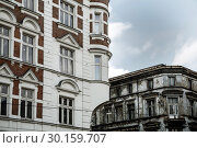 Купить «Poland, Bytom - two old buildings on the market, one renovated, the other empty and run down», фото № 30159707, снято 28 февраля 2018 г. (c) Caro Photoagency / Фотобанк Лори
