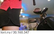 Купить «Playing mini golf. A young blonde woman comes to the bag and taking a golf stick», видеоролик № 30160347, снято 25 марта 2019 г. (c) Константин Шишкин / Фотобанк Лори