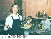 Купить «Female waiter in country restaurant», фото № 30160691, снято 12 ноября 2019 г. (c) Яков Филимонов / Фотобанк Лори