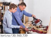 Купить «Woodworker working with pupil», фото № 30160739, снято 17 мая 2017 г. (c) Яков Филимонов / Фотобанк Лори