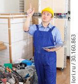 Купить «Builder planning construction works», фото № 30160863, снято 4 мая 2018 г. (c) Яков Филимонов / Фотобанк Лори