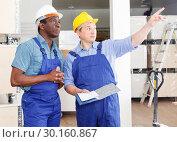 Купить «Builders planning construction works», фото № 30160867, снято 4 мая 2018 г. (c) Яков Филимонов / Фотобанк Лори