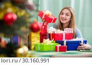 Купить «Portrait of happy girl with X-mas presents at home», фото № 30160991, снято 9 апреля 2020 г. (c) Яков Филимонов / Фотобанк Лори