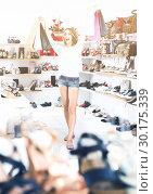 Купить «Woman 20-23 years old is walking with purchases around the store.», фото № 30175339, снято 17 августа 2017 г. (c) Яков Филимонов / Фотобанк Лори