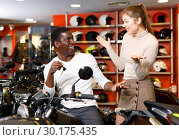 Купить «Happy young couple satisfied with choice in modern motorcycle salon», фото № 30175435, снято 16 января 2019 г. (c) Яков Филимонов / Фотобанк Лори