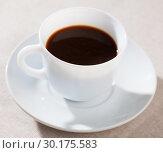 Купить «Image of cup of fresh black coffee americano on table», фото № 30175583, снято 16 октября 2019 г. (c) Яков Филимонов / Фотобанк Лори