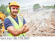 Купить «Demolition construction work. Worker at building site», фото № 30176007, снято 24 июля 2018 г. (c) Дмитрий Калиновский / Фотобанк Лори