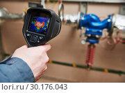Купить «thermal imaging inspection of heating equipment», фото № 30176043, снято 18 февраля 2019 г. (c) Дмитрий Калиновский / Фотобанк Лори