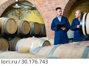 Купить «Two happy men winery employees writing note», фото № 30176743, снято 21 марта 2019 г. (c) Яков Филимонов / Фотобанк Лори