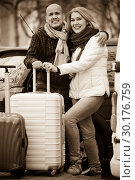 Senior smiling pleasant couple of travellers posing with trollers. Стоковое фото, фотограф Яков Филимонов / Фотобанк Лори