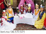 "Children in national Bashkir costumes. Orenburg, Russia - August, 25, 2018: Festival of Slavic Culture ""Legends of Russia 2018"" Редакционное фото, фотограф Вадим Орлов / Фотобанк Лори"