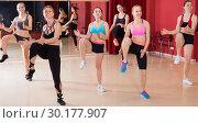 Купить «Women are going to do kick step move», фото № 30177907, снято 31 мая 2017 г. (c) Яков Филимонов / Фотобанк Лори